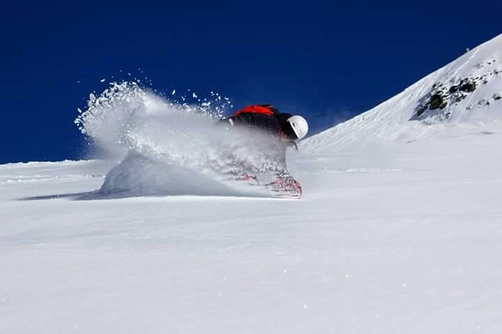 Freeride snowboard in powder