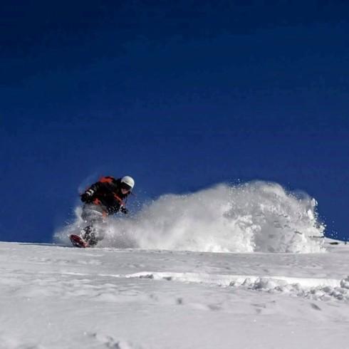 Snowboarder in deep powder snow