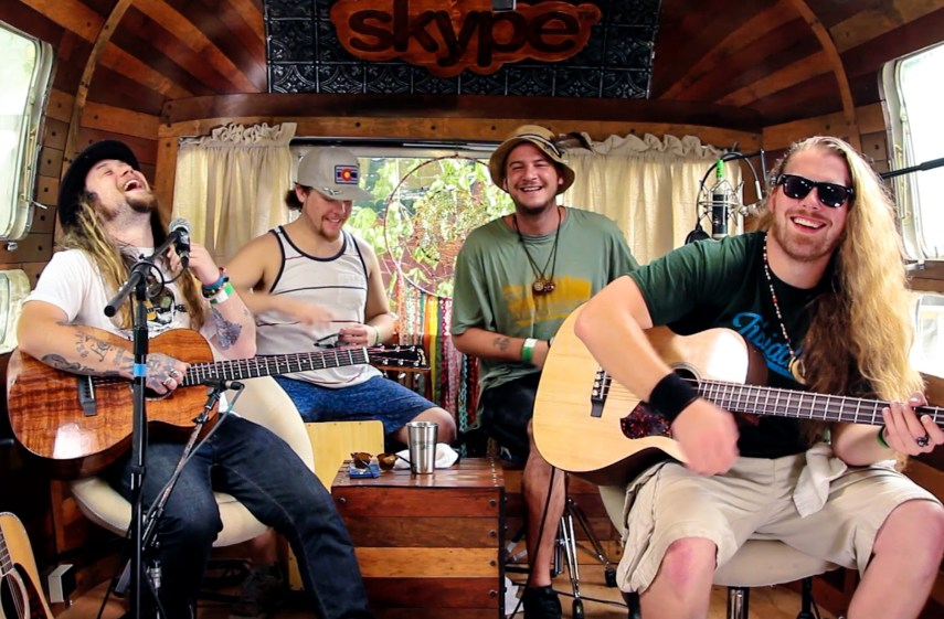 Guys in caravan with guitars