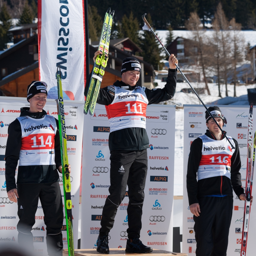 swiss country skiing winner on podium