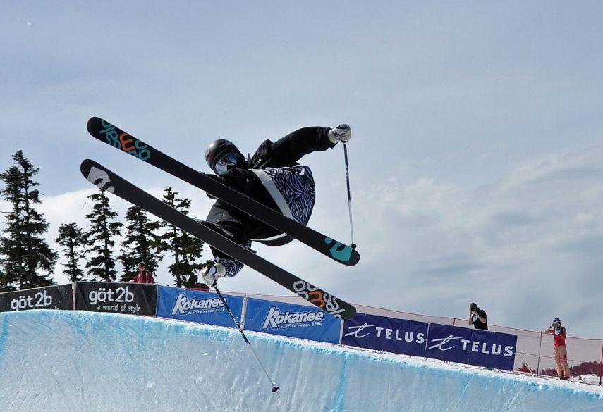 skier mid jump spinning