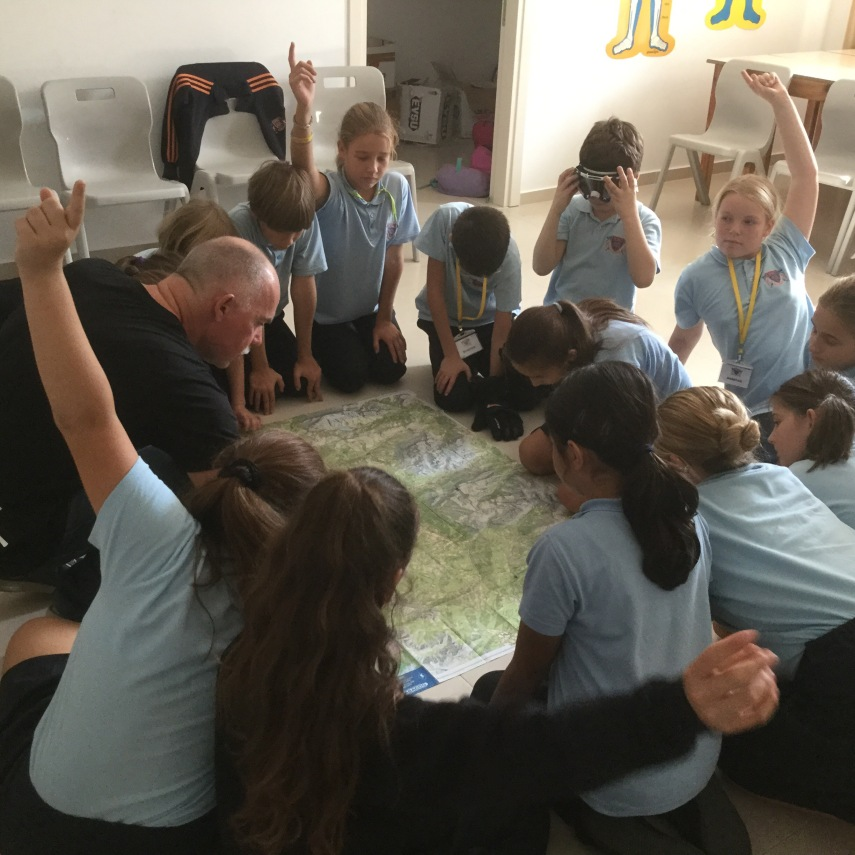 school children being taught how to map read