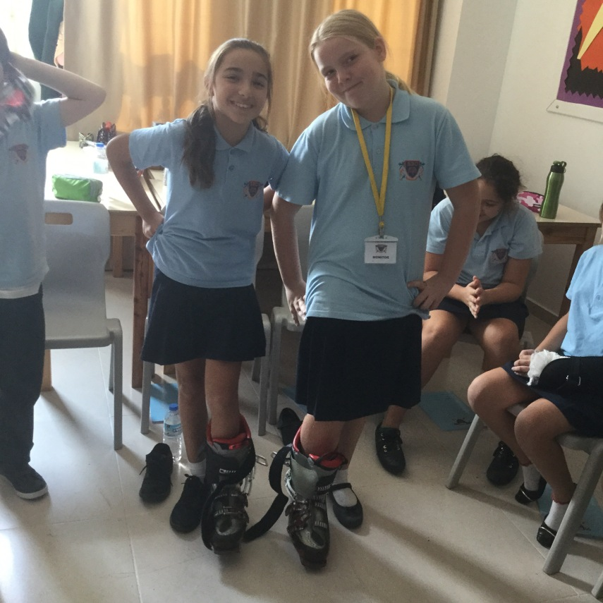 two school girls trying on ski boots