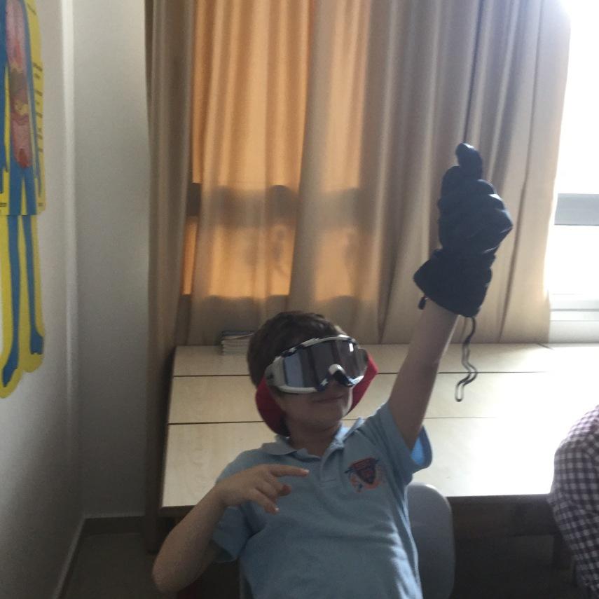 school child trying on ski goggles