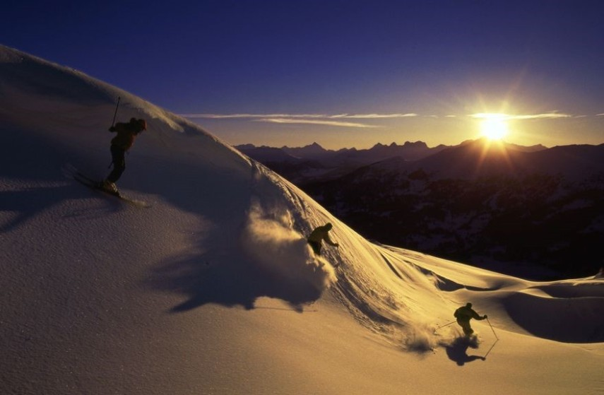 skiing at sunset arosa