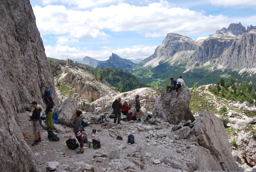 group of people climbing alps summer