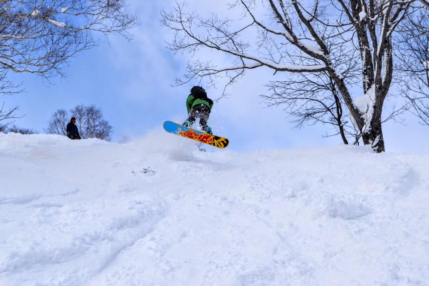 snowboarder in powder sapporo