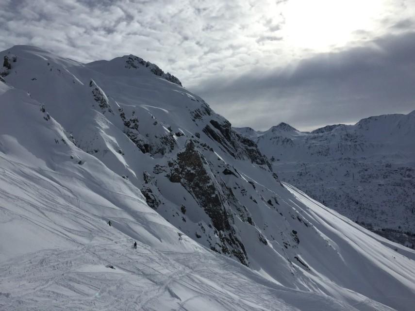 sun shining down on snowy mountain