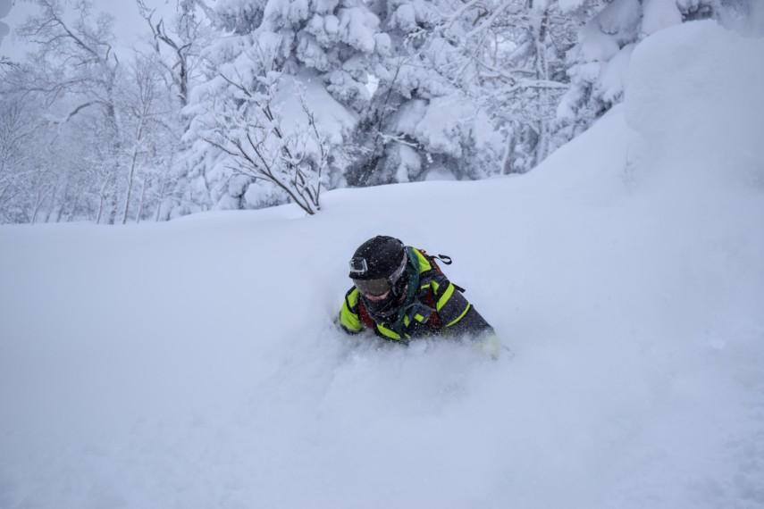 skiing in deep powder in kiroro, japan
